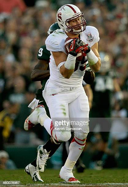 Wide receiver Devon Cajuste of the Stanford Cardinal makes a 51yard catch against the Michigan State Spartans in the third quarter of the 100th Rose...