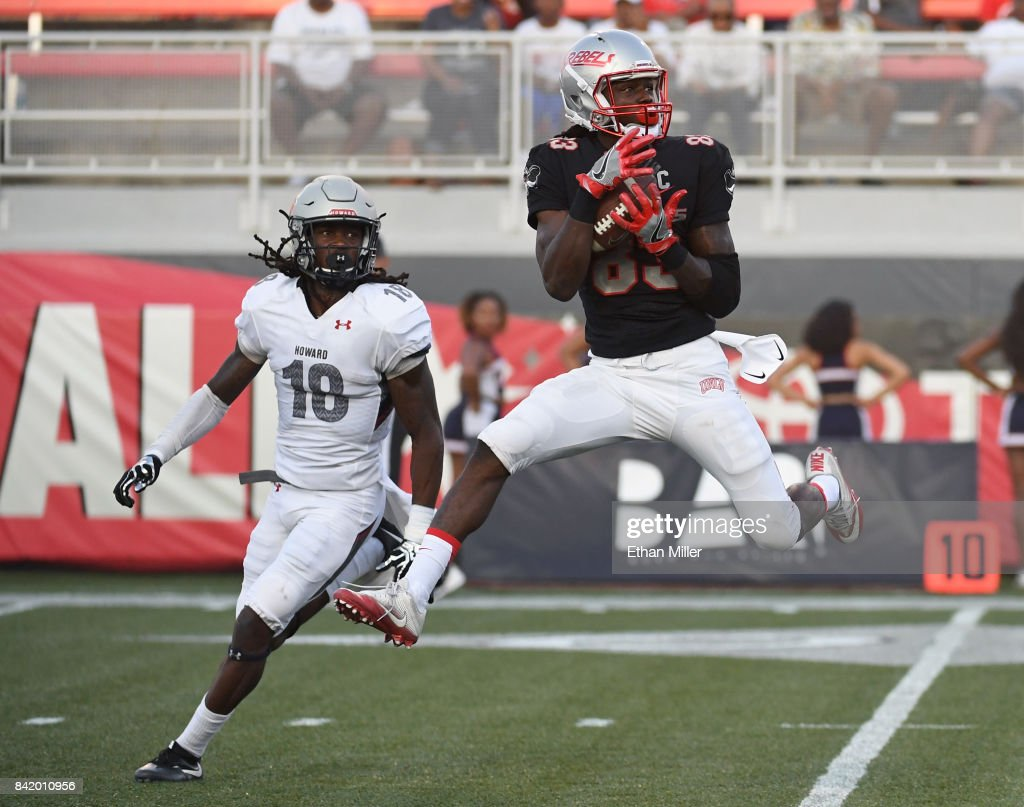 Wide receiver Devonte Boyd #83 of the UNLV Rebels catches a pass for a 46-yard gain against Travon Hunt #18 of the Howard Bison during their game at Sam Boyd Stadium on September 2, 2017 in Las Vegas, Nevada.