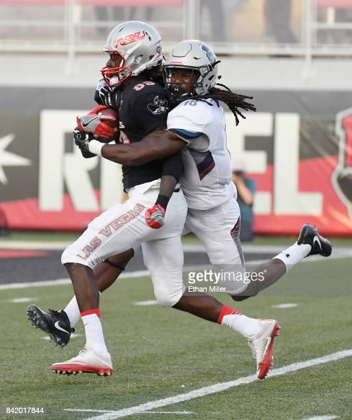 Wide receiver Devonte Boyd of the UNLV Rebels catches a pass for a 46yard gain against Travon Hunt of the Howard Bison during their game at Sam Boyd...