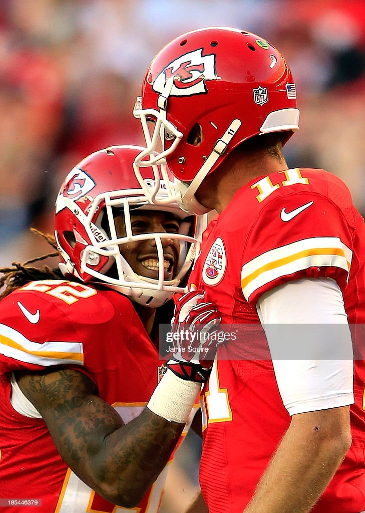 Wide receiver Dexter McCluster #22 of the Kansas City Chiefs celebrates with quarterback Alex Smith #11 after a play during the game at Arrowhead Stadium on October 20, 2013 in Kansas City, Missouri.