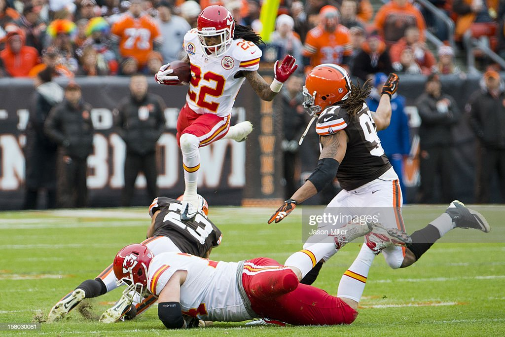 Wide receiver Dexter McCluster #22 of the Kansas City Chiefs jumps over cornerback Joe Haden #23 and tackle Eric Winston #74 of the Kansas City Chiefs while avoiding defensive end Jabaal Sheard #97 of the Cleveland Browns of the Cleveland Browns during the first half at Cleveland Browns Stadium on December 9, 2012 in Cleveland, Ohio.