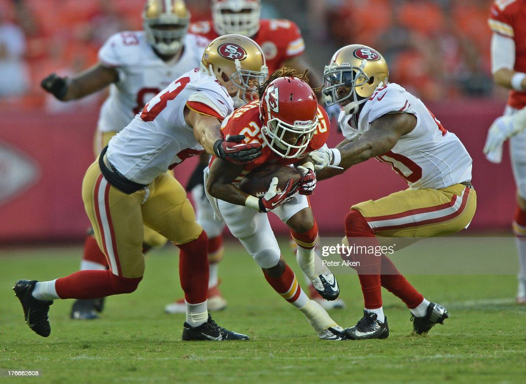 Wide receiver <a gi-track='captionPersonalityLinkClicked' href=/galleries/search?phrase=Dexter+McCluster&family=editorial&specificpeople=5509713 ng-click='$event.stopPropagation()'>Dexter McCluster</a> #22 of the Kansas City Chiefs picks up a first down between defenders <a gi-track='captionPersonalityLinkClicked' href=/galleries/search?phrase=Craig+Dahl&family=editorial&specificpeople=4421268 ng-click='$event.stopPropagation()'>Craig Dahl</a> #43 and <a gi-track='captionPersonalityLinkClicked' href=/galleries/search?phrase=Perrish+Cox&family=editorial&specificpeople=5008136 ng-click='$event.stopPropagation()'>Perrish Cox</a> #20 of the San Francisco 49ers during the first half on August 16, 2013 at Arrowhead Stadium in Kansas City, Missouri.