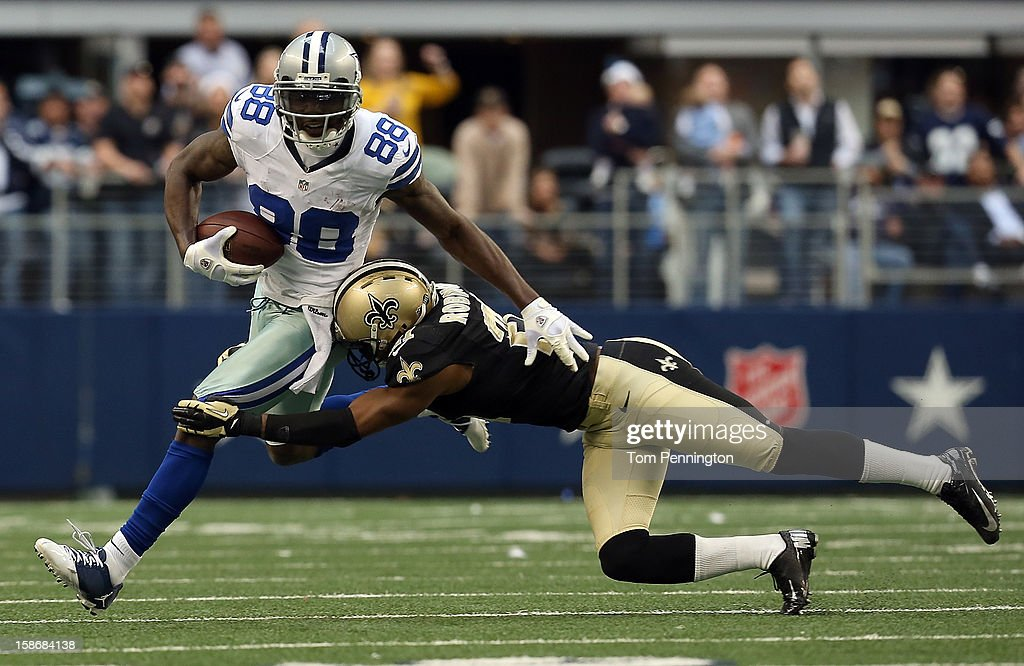 wide receiver <a gi-track='captionPersonalityLinkClicked' href=/galleries/search?phrase=Dez+Bryant&family=editorial&specificpeople=4480158 ng-click='$event.stopPropagation()'>Dez Bryant</a> #88 of the Dallas Cowboys carries the ball against cornerback Patrick Robinson #21 of the New Orleans Saints at Cowboys Stadium on December 23, 2012 in Arlington, Texas. The New Orleans Saints beat the Dallas Cowboys 34-31 in overtime.