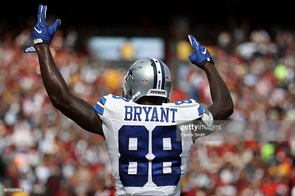 Wide receiver Dez Bryant #88 of the Dallas Cowboys celebrates after quarterback Dak Prescott #4 (not pictured) of the Dallas Cowboys scores a third quarter touchdown against the Washington Redskins at FedExField on September 18, 2016 in Landover, Maryland.