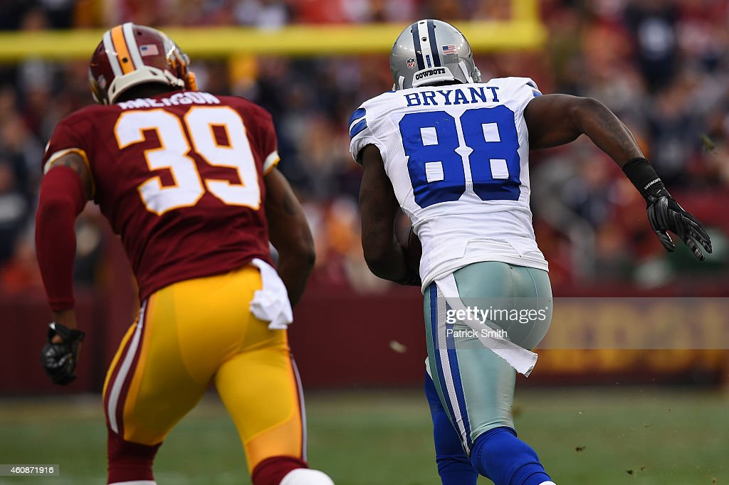 wide receiver <a gi-track='captionPersonalityLinkClicked' href=/galleries/search?phrase=Dez+Bryant&family=editorial&specificpeople=4480158 ng-click='$event.stopPropagation()'>Dez Bryant</a> #88 of the Dallas Cowboys eludes cornerback <a gi-track='captionPersonalityLinkClicked' href=/galleries/search?phrase=David+Amerson&family=editorial&specificpeople=7244765 ng-click='$event.stopPropagation()'>David Amerson</a> #39 of the Washington Redskins before scoring a first quarter touchdown at FedExField on December 28, 2014 in Landover, Maryland.