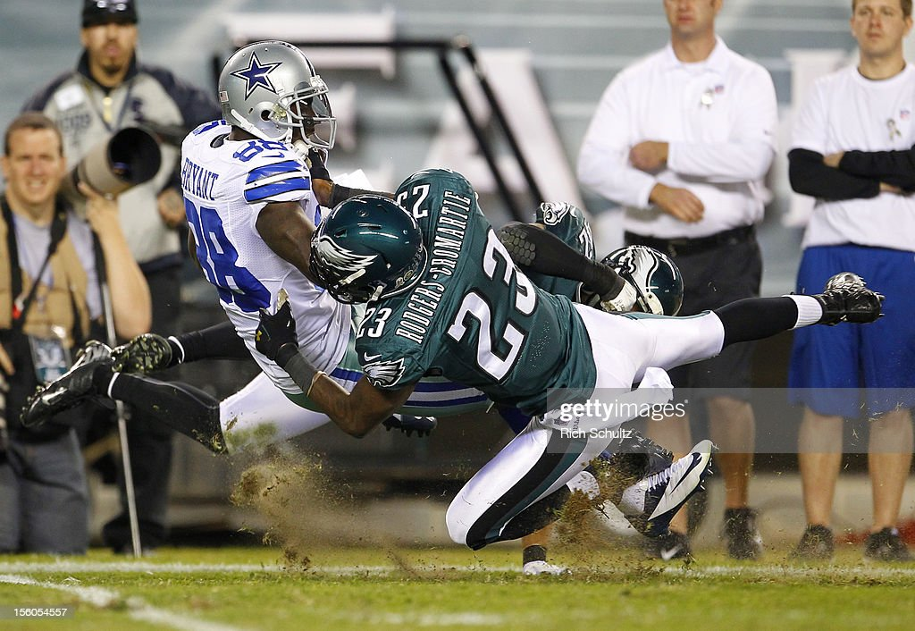 Wide receiver <a gi-track='captionPersonalityLinkClicked' href=/galleries/search?phrase=Dez+Bryant&family=editorial&specificpeople=4480158 ng-click='$event.stopPropagation()'>Dez Bryant</a> #88 of the Dallas Cowboys is tackled after making a catch by Dominique Rodgers-Cromartie #23 of the Philadelphia Eagles during the first half of a game at Lincoln Financial Field on November 11, 2012 in Philadelphia, Pennsylvania.