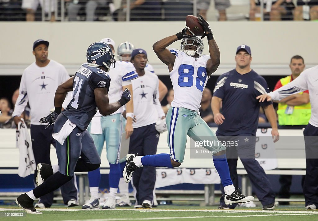 Wide receiver Dez Bryant #88 of the Dallas Cowboys makes a catch while being pursued by Kam Chancellor #31 of the Seattle Seahawks in the first half at Cowboys Stadium on November 6, 2011 in Arlington, Texas.