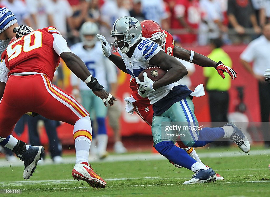 Wide receiver <a gi-track='captionPersonalityLinkClicked' href=/galleries/search?phrase=Dez+Bryant&family=editorial&specificpeople=4480158 ng-click='$event.stopPropagation()'>Dez Bryant</a> #88 of the Dallas Cowboys rushes through defenders of the Kansas City Chiefs after catching a pass during the first half on September 15, 2013 at Arrowhead Stadium in Kansas City, Missouri. Kansas City defeated Dallas 17-16.