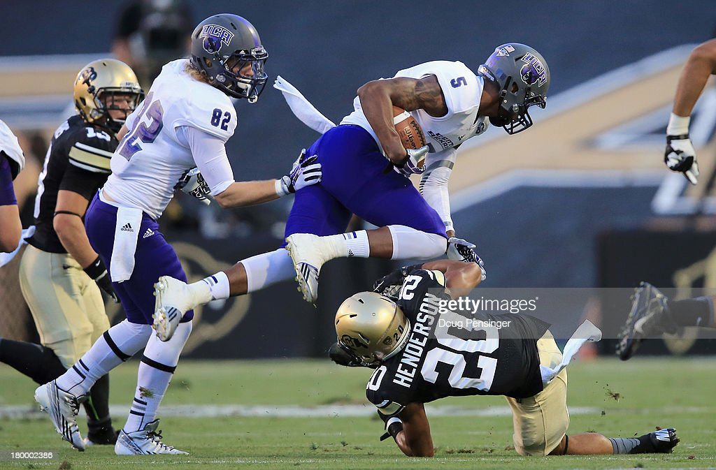 Wide receiver Dezmin Lewis #5 of the Central Arkansas Bears makes a first down pass reception as defensive back <a gi-track='captionPersonalityLinkClicked' href=/galleries/search?phrase=Greg+Henderson&family=editorial&specificpeople=171423 ng-click='$event.stopPropagation()'>Greg Henderson</a> #20 of the Colorado Buffaloes makes the tackle at Folsom Field on September 7, 2013 in Boulder, Colorado.