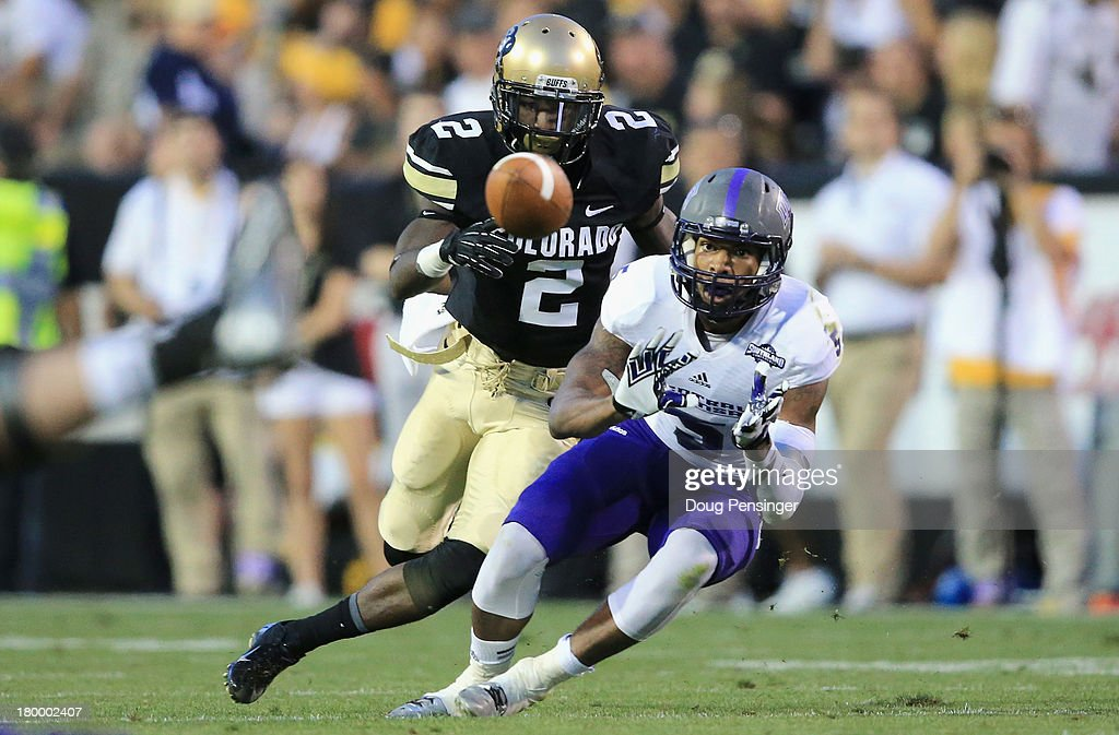 Wide receiver Dezmin Lewis #5 of the Central Arkansas Bears makes a first down pass reception against the defense of defensive back Kenneth Crawley #2 of the Colorado Buffaloes at Folsom Field on September 7, 2013 in Boulder, Colorado. The Buffaloes defeated the Bears 38-24.