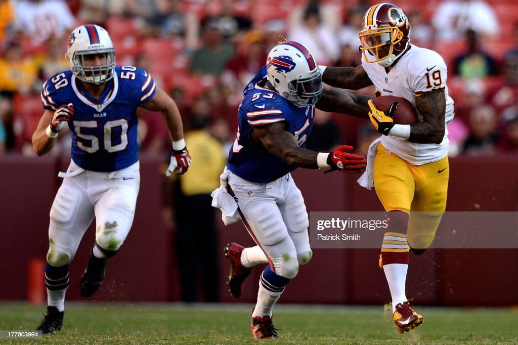Wide receiver Dezmon Briscoe #19 of the Washington Redskins eludes linebacker <a gi-track='captionPersonalityLinkClicked' href=/galleries/search?phrase=Nigel+Bradham&family=editorial&specificpeople=6579576 ng-click='$event.stopPropagation()'>Nigel Bradham</a> #53 of the Buffalo Bills and teammate Kiko Alonso #50 in the third quarter during a preseason game at FedExField on August 24, 2013 in Landover, Maryland. The Washington Redskins won, 30-7.