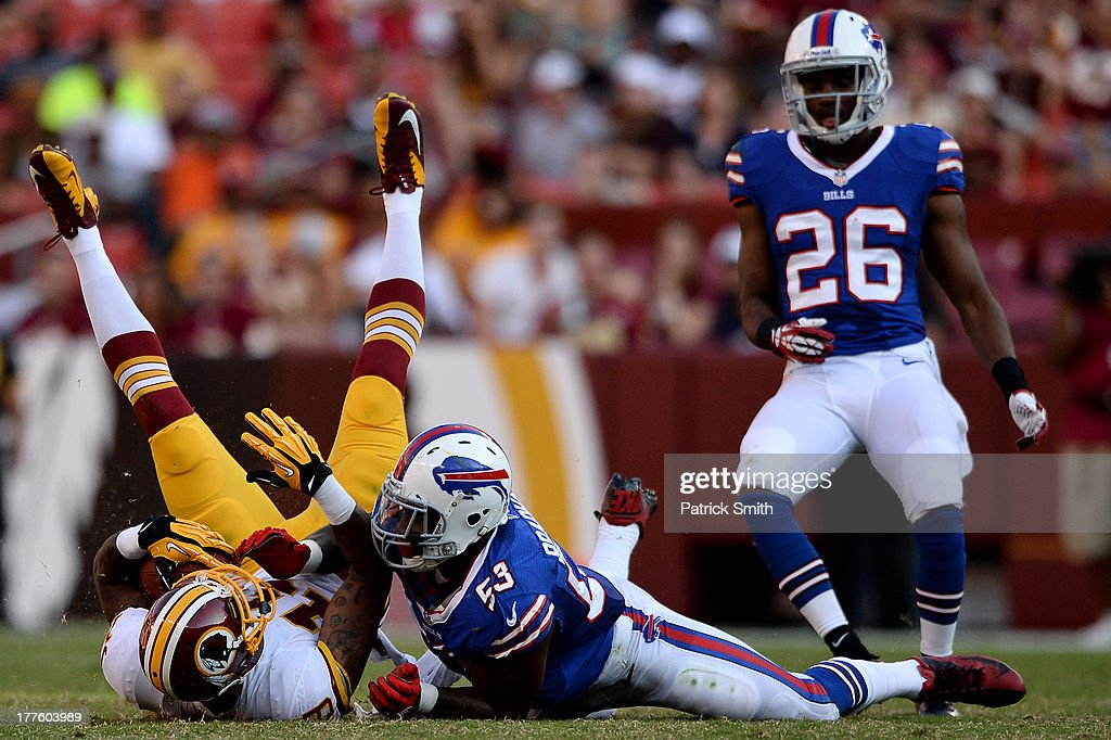 Wide receiver Dezmon Briscoe #19 of the Washington Redskins is pulled down by linebacker <a gi-track='captionPersonalityLinkClicked' href=/galleries/search?phrase=Nigel+Bradham&family=editorial&specificpeople=6579576 ng-click='$event.stopPropagation()'>Nigel Bradham</a> #53 of the Buffalo Bills in the third quarter during a preseason game at FedExField on August 24, 2013 in Landover, Maryland. The Washington Redskins won, 30-7.