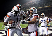 Wide receiver D'haquille Williams of the Auburn Tigers is congratulated by teammates after making a catch in the endzone for a touchdown during the...