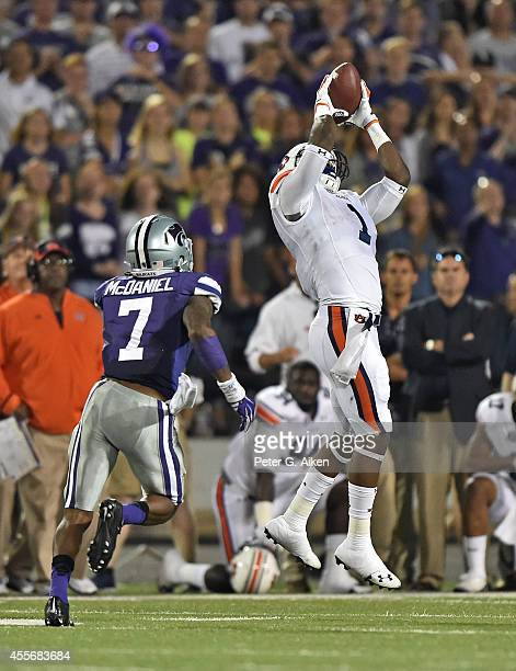 Wide receiver D'haquille Williams of the Auburn Tigers make a catch over defensive back Danzel McDaniel of the Kansas State Wildcats late in the...