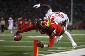 Wide receiver DJ Moore of the Maryland Terrapins scores touchdown in front of cornerback Derrick Tindal of the Wisconsin Badgers during the second...