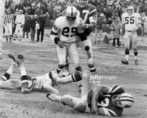 Wide receiver Don Maynard of the New York Jets falls into the end zone with his second touchdown after taking a pass from quarterback Joe Namath in...