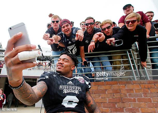Wide receiver Donald Gray of the Mississippi State Bulldogs poses for a selfie with fans after the end of an NCAA college football game at Davis Wade...