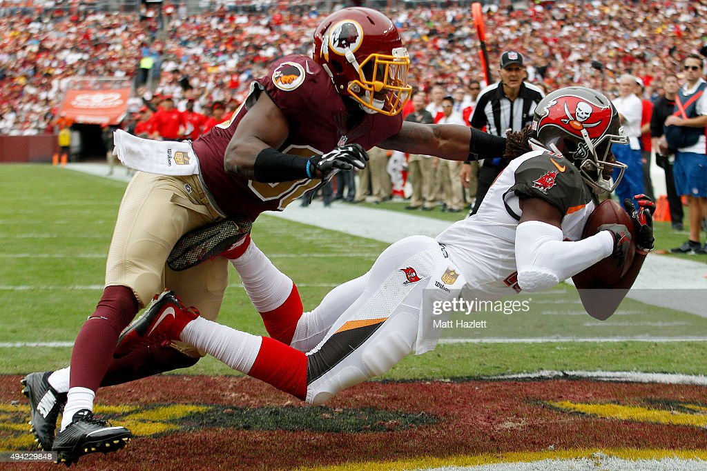 Wide receiver Donteea Dye of the Tampa Bay Buccaneers scores a second quarter touchdown past strong safety Kyshoen Jarrett of the Washington Redskins...