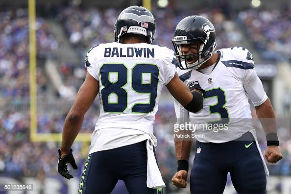 Wide receiver Doug Baldwin of the Seattle Seahawks celebrates with quarterback Russell Wilson after scoring a second quarter touchdown against the...