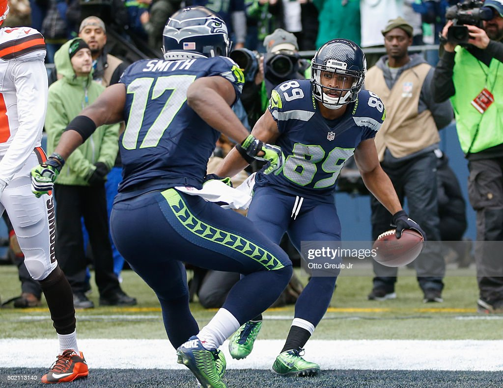 Wide receiver Doug Baldwin #89 of the Seattle Seahawks celebrates with wide receiver Kevin Smith #17 after scoring a touchdown against the Cleveland Browns at CenturyLink Field on December 20, 2015 in Seattle, Washington.