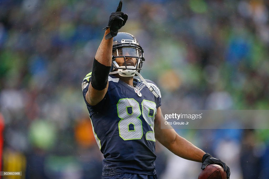 Wide receiver Doug Baldwin #89 of the Seattle Seahawks reacts after scoring a touchdown in the third quarter against the St. Louis Rams at CenturyLink Field on December 27, 2015 in Seattle, Washington. The Rams defeated the Seahawks 23-17.