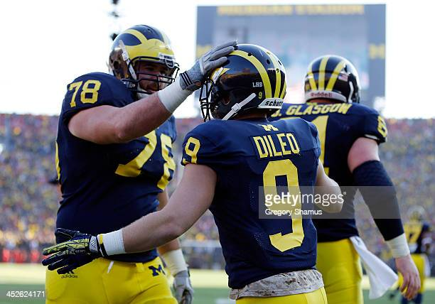 Wide receiver Drew Dileo of the Michigan Wolverines celebrates a fourth quarter touchdown with offensive linesman Erik Magnuson against the Ohio...