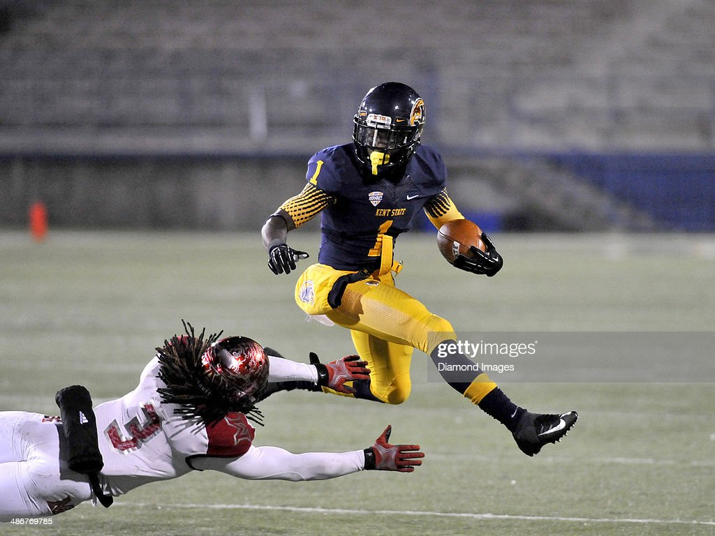 Wide receiver <a gi-track='captionPersonalityLinkClicked' href=/galleries/search?phrase=Dri+Archer&family=editorial&specificpeople=9689813 ng-click='$event.stopPropagation()'>Dri Archer</a> #1 of the Kent State Golden Flashes leaps over a defender during a game against the Miami Redhawks on November 13, 2013 at Dix Stadium in Kent, Ohio. Kent State won 24-6.