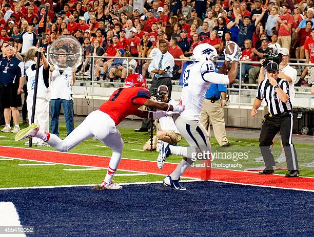 Wide receiver Dustin Treick of the Nevada Wolf catches a 6 yard touchdown pass against cornerback Cam Denson of the Arizona Wildcats at Arizona...