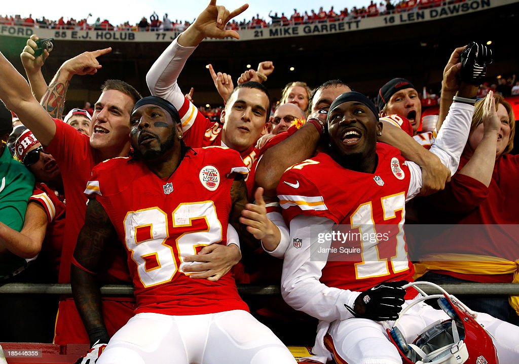 Wide receiver Dwayne Bowe #82 and wide receiver Donnie Avery #17 of the Kansas City Chiefs celebrate by jumping into the crowd as the Chiefs defeat the Houston Texans 17-16 to win the game at Arrowhead Stadium on October 20, 2013 in Kansas City, Missouri.