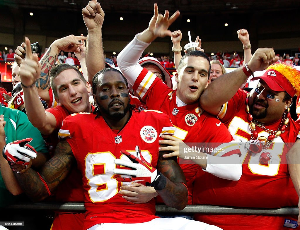 Wide receiver Dwayne Bowe #82 of the Kansas City Chiefs celebrates by jumping into the crowd as the Chiefs defeat the Houston Texans 17-16 to win the game at Arrowhead Stadium on October 20, 2013 in Kansas City, Missouri.