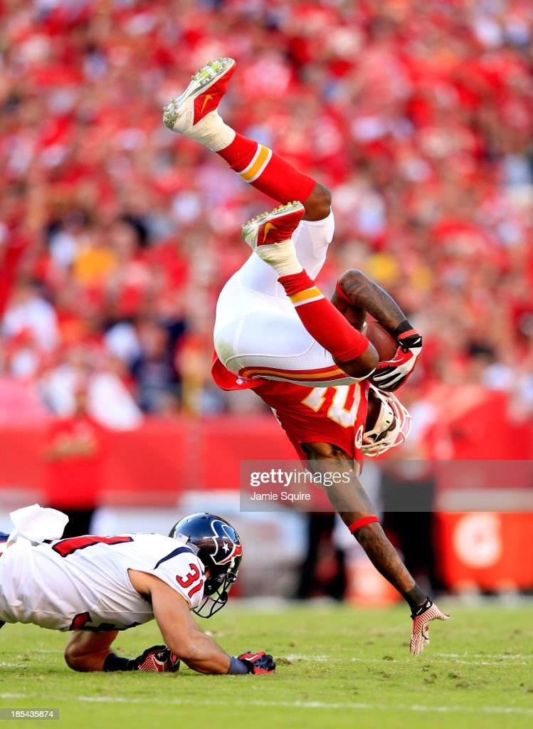 Wide receiver Dwayne Bowe #82 of the Kansas City Chiefs is upended by free safety Shiloh Keo #31 of the Houston Texans after making a catch during the 1st half of the game at Arrowhead Stadium on October 20, 2013 in Kansas City, Missouri.