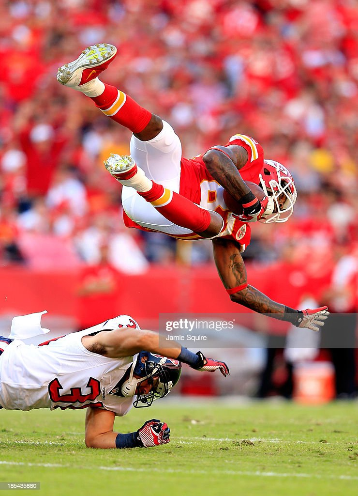 Wide receiver <a gi-track='captionPersonalityLinkClicked' href=/galleries/search?phrase=Dwayne+Bowe&family=editorial&specificpeople=2139865 ng-click='$event.stopPropagation()'>Dwayne Bowe</a> #82 of the Kansas City Chiefs is upended by free safety <a gi-track='captionPersonalityLinkClicked' href=/galleries/search?phrase=Shiloh+Keo&family=editorial&specificpeople=4485168 ng-click='$event.stopPropagation()'>Shiloh Keo</a> #31 of the Houston Texans after making a catch during the 1st half of the game at Arrowhead Stadium on October 20, 2013 in Kansas City, Missouri.