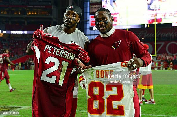 Wide receiver Dwayne Bowe of the Kansas City Chiefs poses with cornerback Patrick Peterson of the Arizona Cardinals after trading jerseys after the...
