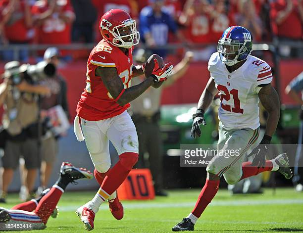 Wide receiver Dwayne Bowe of the Kansas City Chiefs runs past free safety Ryan Mundy of the New York Giants for a 34yard touchdown during the second...