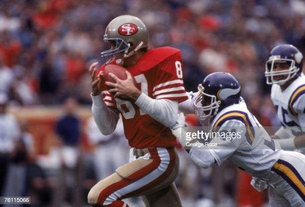 Wide receiver Dwight Clark of the San Francisco 49ers catches a pass against defensive back Rufus Bess of the Minnesota Vikings during a game at...