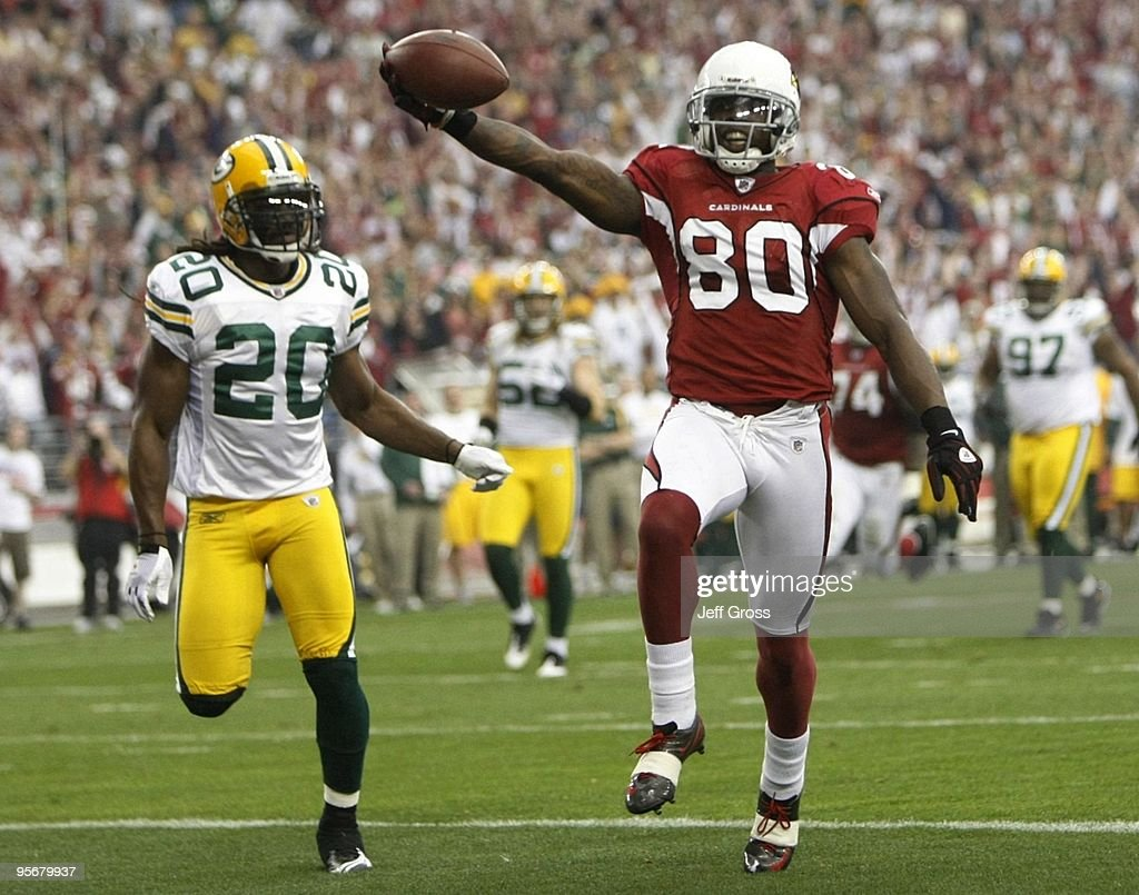 Wide receiver Early Doucet #80 of the Arizona Cardinals scores a touchdown against the Green Bay Packers during the first quarter of the 2010 NFC wild-card playoff game at University of Phoenix Stadium on January 10, 2010 in Glendale, Arizona.