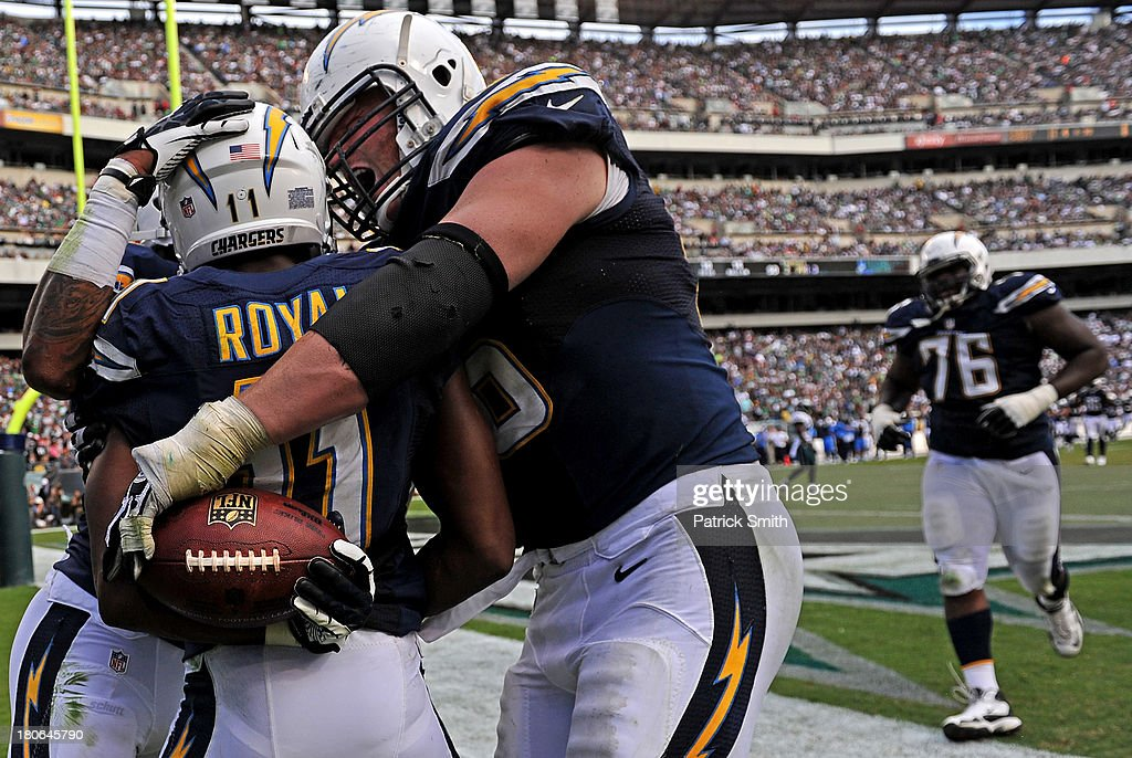 Wide receiver <a gi-track='captionPersonalityLinkClicked' href=/galleries/search?phrase=Eddie+Royal&family=editorial&specificpeople=2132149 ng-click='$event.stopPropagation()'>Eddie Royal</a> #11 of the San Diego Chargers celebrates with teammates after scoring a touchdown against the Philadelphia Eagles in the fourth quarter at Lincoln Financial Field on September 15, 2013 in Philadelphia, Pennsylvania. The San Diego Chargers won, 33-30.