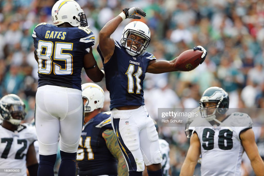 Wide receiver <a gi-track='captionPersonalityLinkClicked' href=/galleries/search?phrase=Eddie+Royal&family=editorial&specificpeople=2132149 ng-click='$event.stopPropagation()'>Eddie Royal</a> #11 of the San Diego Chargers celebrates with teammate <a gi-track='captionPersonalityLinkClicked' href=/galleries/search?phrase=Antonio+Gates&family=editorial&specificpeople=184491 ng-click='$event.stopPropagation()'>Antonio Gates</a> #85 in the end zone after making a catch for a 15 yard touchdown catch against the Philadelphia Eagles during the fourth quarter at Lincoln Financial Field on September 15, 2013 in Philadelphia, Pennsylvania. The Chargers defeated the Eagles 33-30.