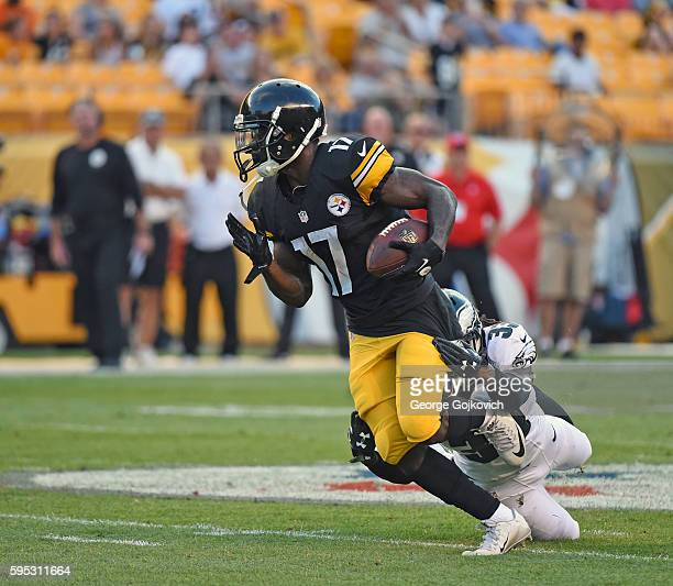 Wide receiver Eli Rogers of the Pittsburgh Steelers is tackled by cornerback Ron Brooks of the Philadelphia Eagles during a National Football League...