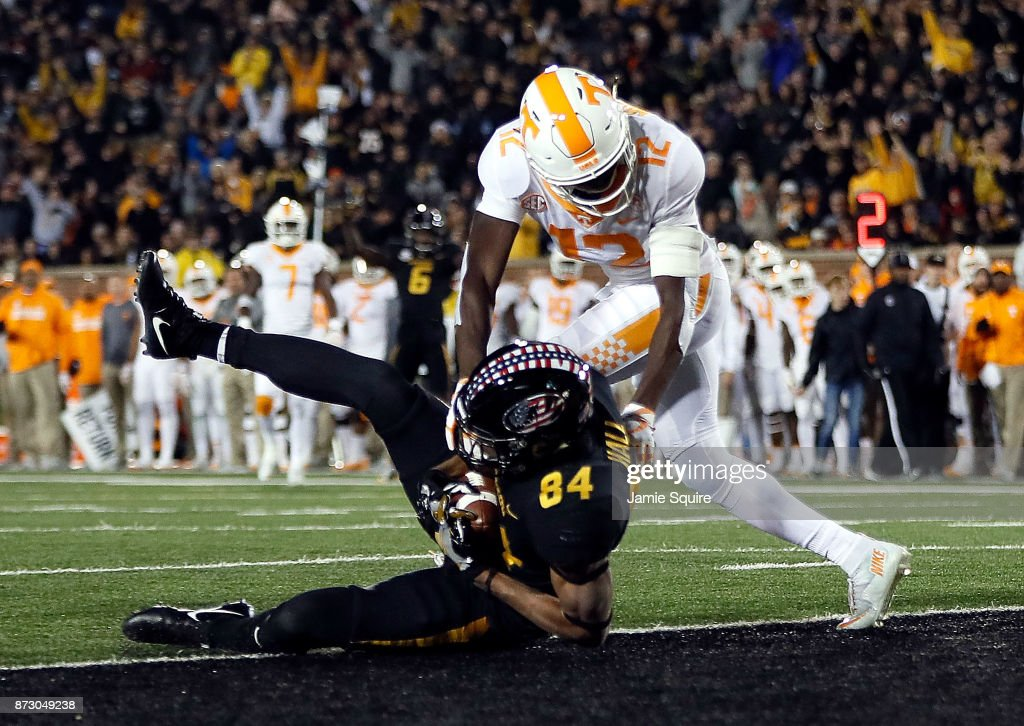 Wide receiver Emanuel Hall #84 of the Missouri Tigers falls into the endzone for a touchdown as defensive back Emmanuel Moseley #12 of the Tennessee Volunteers defends during the game at Faurot Field/Memorial Stadium on November 11, 2017 in Columbia, Missouri.