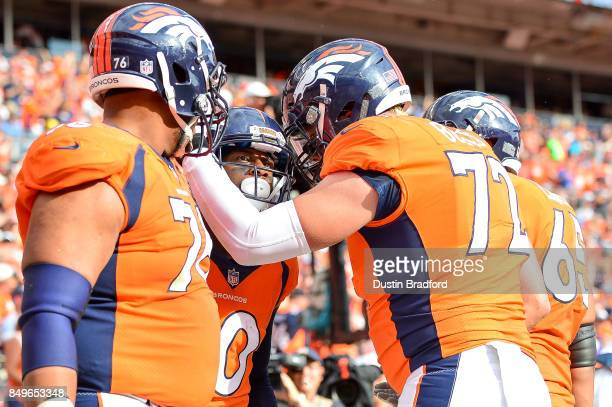 Wide receiver Emmanuel Sanders of the Denver Broncos celebrates with Max Garcia Garett Bolles and Ronald Leary after scoring a second quarter...