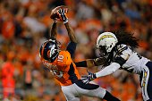 Wide receiver Emmanuel Sanders of the Denver Broncos has a second quarter catch as cornerback Jason Verrett of the San Diego Chargers defends during...