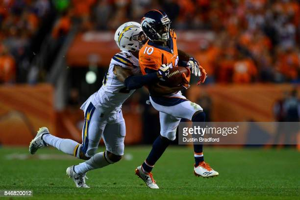 Wide receiver Emmanuel Sanders of the Denver Broncos is tackled by cornerback Trevor Williams of the Los Angeles Chargers in the third quarter of the...