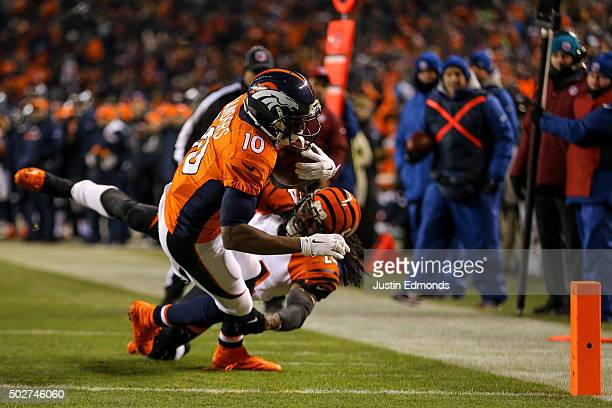 Wide receiver Emmanuel Sanders of the Denver Broncos makes a reception for an 8yard touchdown under coverage by cornerback Adam Jones of the...