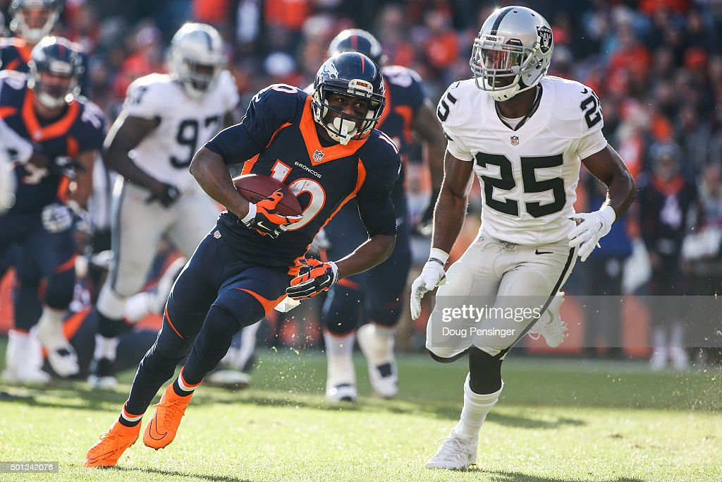 Wide receiver Emmanuel Sanders of the Denver Broncos runs for an 11yard gain and is pursued by cornerback DJ Hayden of the Oakland Raiders after a...