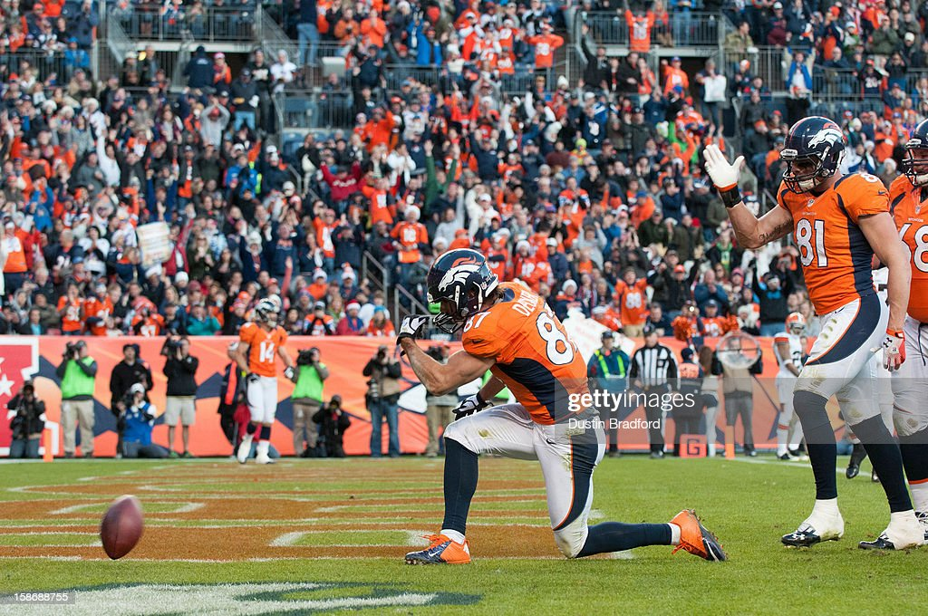 Wide receiver <a gi-track='captionPersonalityLinkClicked' href=/galleries/search?phrase=Eric+Decker&family=editorial&specificpeople=3950667 ng-click='$event.stopPropagation()'>Eric Decker</a> #87 of the Denver Broncos celebrates a touchdown reception against the Cleveland Browns during a game at Sports Authority Field Field at Mile High on December 23, 2012 in Denver, Colorado. The Broncos defeated the Browns 34-12.