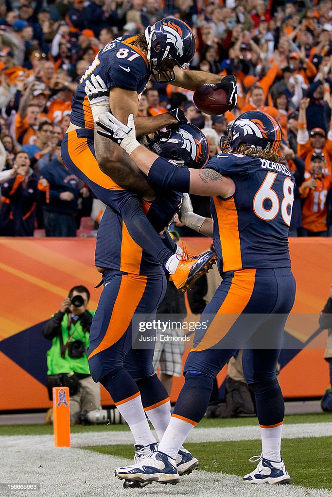 Wide receiver Eric Decker #87 of the Denver Broncos celebrates his 20-yard touchdown with Offensive tackle Orlando Franklin #74 and Guard Zane Beadles #68 during the third quarter against the San Diego Chargers at Sports Authority Field Field at Mile High on November 18, 2012 in Denver, Colorado. The Broncos defeated the Chargers 30-23.