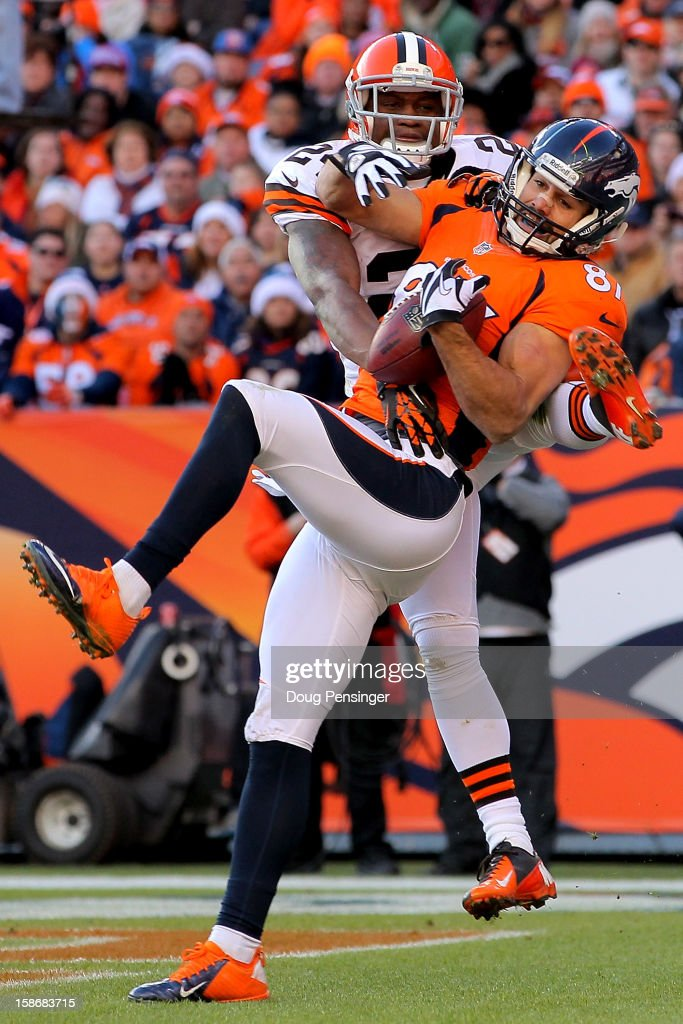 Wide receiver Eric Decker #87 of the Denver Broncos makes a 10 yard touchdown reception against cornerback Sheldon Brown #24 of the Cleveland Browns in the second quarter at Sports Authority Field at Mile High on December 23, 2012 in Denver, Colorado.