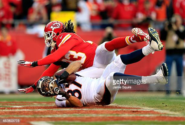 Wide receiver Eric Decker of the Denver Broncos makes a catch in the end zone for a touchdown as free safety Kendrick Lewis of the Kansas City Chiefs...