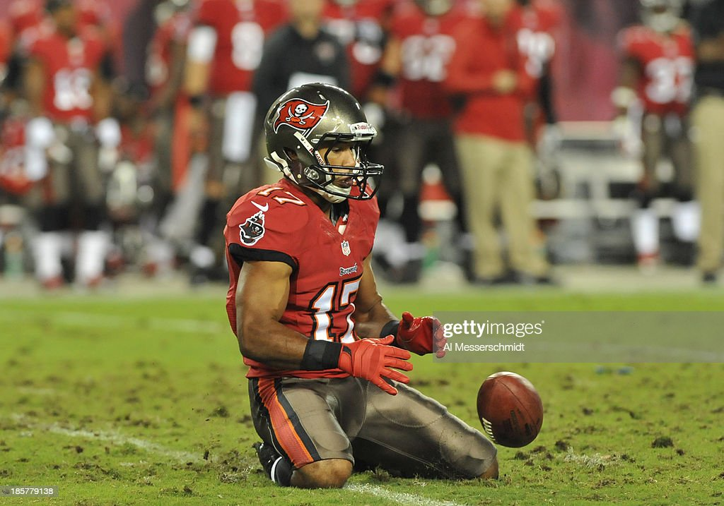 Wide receiver <a gi-track='captionPersonalityLinkClicked' href=/galleries/search?phrase=Eric+Page&family=editorial&specificpeople=6234985 ng-click='$event.stopPropagation()'>Eric Page</a> #17 of the Tampa Bay Buccaneers fumbles a punt return against the Carolina Panthers October 24, 2013 at Raymond James Stadium in Tampa, Florida. Carolina recovered and won 31 - 13.